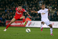 SWANSEA, WALES - MARCH 16: Wayne Routledge of Swansea (R) has his shot blocked by Philippe Coutinho of Liverpool during the Premier League match between Swansea City and Liverpool at the Liberty Stadium on March 16, 2015 in Swansea, Wales
