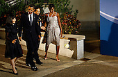 Pittsburgh, PA - September 24, 2009 -- United States President Barack Obama (2L) escorts Japanese first lady Miyuki Hatayama (L) as he greets Japanese Prime Minister Yukio Hatoyama (2R) with U.S. first lady Michelle Obama before the opening dinner for G-20 leaders at the Phipps Conservatory on Thursday, September 24, 2009 in Pittsburgh, Pennsylvania. Heads of state from the world's leading economic powers arrived today for the two-day G-20 summit held at the David L. Lawrence Convention Center aimed at promoting economic growth.  .Credit: Win McNamee / Pool via CNP