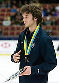 Team USA captain Taylor Chorney (Hastings, Minnesota - University of North Dakota) collects the Bronze. Team Canada (gold), Team Russia (silver) and Team USA line up for the individual awards and team medal presentations following Team Canada's 4-2 victory over Team Russia to win the gold in the 2007 World Championship on Friday, January 5, 2007 at Ejendals Arena in Leksand, Sweden.