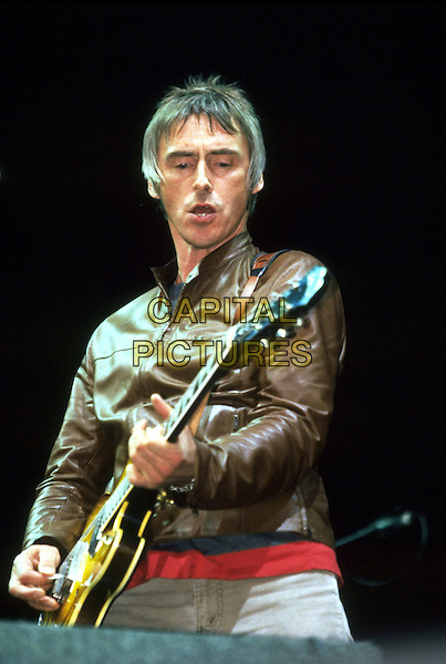 PAUL WELLER.in concert, playing guitar half length stage gig performance music live .SALES REF: 9933.INTERNAL REF: 4500/88/JM .Ref: JM.www.capitalpictures.com.sales@capitalpictures.com.©James McCauley/Capital Picturesc