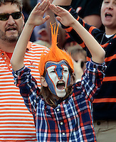 Virginia fan Kyle Mahoney sings the good ole song during the game Saturday at Scott Stadium in Charlottesville, VA. Clemson defeated Virginia 59-10.  Photo/Andrew Shurtleff
