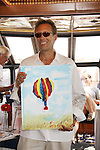 All My Children Walt Willey auctions off his painting of a hot air balloon from New Mexico at the Cruisin' & Schmoozin' with the Stars on the Marco Island Princess sightseeing tour of beautiful Marco Island, watching the dolphins, autographs, photos, auctions & a buffet luncheon on May 15 Marco Island, Florida - SWFL Soapfest Charity Weekend May 14 & !5, 2011 benefitting several children's charities including the Eimerman Center providing educational & outreach services for children for autism. see www.autismspeaks.org. (Photo by Sue Coflin/Max Photos)
