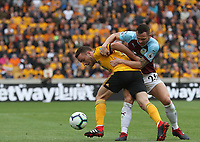 Burnley's Phillip Bardsley and Wolverhampton Wanderers' Raul Jimenez<br /> <br /> Photographer Rachel Holborn/CameraSport<br /> <br /> The Premier League - Wolverhampton Wanderers v Burnley - Sunday 16th September 2018 - Molineux - Wolverhampton<br /> <br /> World Copyright &copy; 2018 CameraSport. All rights reserved. 43 Linden Ave. Countesthorpe. Leicester. England. LE8 5PG - Tel: +44 (0) 116 277 4147 - admin@camerasport.com - www.camerasport.com