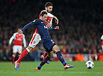 Arsenal's Olivier Giroud tussles with PSG's Gregorz Krychowiak during the Champions League group A match at the Emirates Stadium, London. Picture date November 23rd, 2016 Pic David Klein/Sportimage
