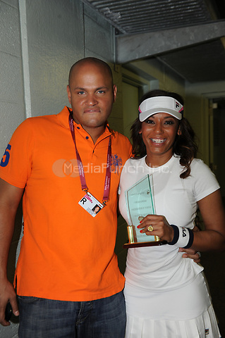 Orig pix taken - on March 23, 2010 in Key Biscayne, Florida.<br /> <br />MIAMI BEACH, FL- AUGUST 29:  (www.mirror.co.uk)   Spice Girl Mel B&Otilde;s three-year marriage is FINISHED, her husband Stephen Belafonte has revealed. The film producer told me in an emotional telephone outburst from the States: &Ograve;Dude, it&Otilde;s over. Mel&Otilde;s coming back to the UK soon &ETH; but I won&Otilde;t be coming with her.&Oacute; And I can reveal he has talked to lawyers in Los Angeles about a divorce from Scary Spice Mel.<br />The couple wed in 2007 just six months after Mel&Otilde;s bitter split from actor Eddie Murphy &ETH; dad of her daughter Angel, three. Only days ago the couple, both 35, were photographed kissing over lunch, and Mel has posted Twitter updates referring to her &Ograve;hubby&Oacute;.<br />But pals have said for months that the pair&Otilde;s rollercoaster relationship was finally hitting the rocks.<br />And now Belafonte admits ?divorce is on the way. He told me: &Ograve;There&Otilde;s been problems lately. I don&Otilde;t know what&Otilde;s happening.&Oacute;<br />A friend of Mel said: &Ograve;They&Otilde;ve not been happy for a long time and there&Otilde;s been rowing.<br /><br /><br />&Ograve;Mel&Otilde;s been talking about getting out. They&Otilde;re still talking to see if things can be worked out.<br />&Ograve;But she&Otilde;s making plans to come back to the UK on a more ?permanent basis. Stephen hasn&Otilde;t been ?mentioned as joining her and has been consulting lawyers.&Oacute;<br />When the couple wed in Las Vegas Mel&Otilde;s mother Andrea called it a &Ograve;big mistake&Oacute;. Just weeks later it emerged Stephen had attacked his ex Nicole Contreras &ETH; mum of his daughter Giselle, six &ETH; in 2003. Mel and Belafonte will have to decide what to do about access to each other&Otilde;s children &ETH; Mel also has daughter Phoenix, 11, from her first marriage to dancer Jimmy Gulzar.<br />Ironically, US TV viewers will next week see the fa
