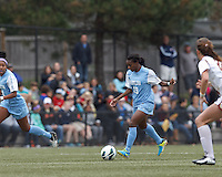 University of North Carolina midfielder Crystal Dunn (19) brings the ball forward.   University of North Carolina (blue) defeated Boston College (white), 1-0, at Newton Campus Field, on October 13, 2013.