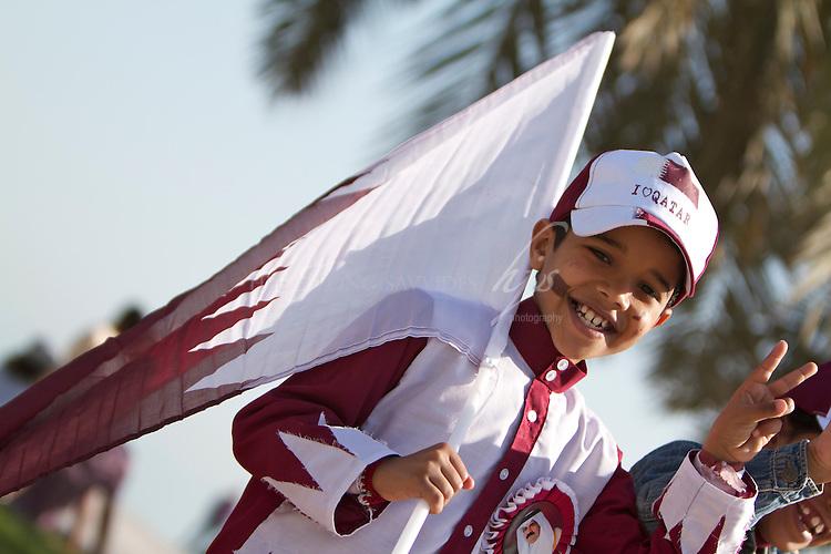 Qatari Boy  with a 'I love Qatar' cap, Qatar National Day, Doha, Qatar   Dec 10
