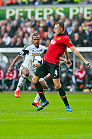 Saturday 17 August 2013<br /> <br /> Pictured: Wayne Routledge of Swansea and Phil Jones of Manchester United<br /> <br /> Re: Barclays Premier League Swansea City v Manchester United at the Liberty Stadium, Swansea, Wales
