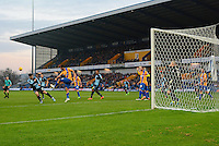 Mansfield Town's Ryan Tafazolli clears the danger from a Wycombe Wanderers corner kick during the Sky Bet League 2 match between Mansfield Town and Wycombe Wanderers at the One Call Stadium, Mansfield, England on 31 October 2015. Photo by Garry Griffiths.