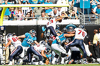 November 27, 2011:   Houston Texans running back Arian Foster (23) goes up and over the pile for a first half touchdown during action between the Jacksonville Jaguars and the Houston Texans played at EverBank Field in Jacksonville, Florida.  ........