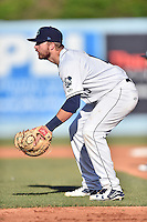Asheville Tourists first baseman Brian Mundell (15) awaits the play during game one of a double header against the Kannapolis Intimidators at McCormick Field on May 21, 2016 in Asheville, North Carolina. The Tourists defeated the Intimidators in game one 3-2. (Tony Farlow/Four Seam Images)
