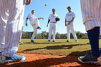 South Dakota State JackRabbits players Mitch Foster, Al Robbins, Matt Johnson (L-R) hacky before a game against the Maine Black Bears at South County Regional Park on March 9, 2014 in Port Charlotte, Florida.  Maine defeated South Dakota 5-4.  (Mike Janes/Four Seam Images)