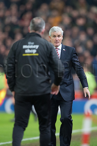 07.01.2017. bet365 Stadium, Stoke, England. FA Cup third round football. Stoke versus Wolverhampton Wanderers. Stoke manager Mark Hughes looks shocked at the result as he shakes hands with Wolves head coach Paul Lambert.