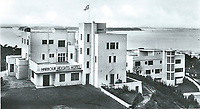 BNPS.co.uk (01202 558833)<br /> Pic: PHT/BNPS<br /> <br /> 1930's - The Harbour Heights Hotel was home to BOAC Flying Boat crews.<br /> <br /> Plans to transform the millionaire's resort of Sandbanks into 'Britain's Miami Beach' with two new superhotel's and apartments as part of a &pound;250m development have been unveiled. <br /> <br /> A pair of century-old hotels on the exclusive Dorset peninsula will be bulldozed to make way for an extravagant five star hotel on the beach and a smaller hotel with apartments on the cliffs above.<br /> <br /> The luxurious 175 room establishment will replace the existing Sandbanks Hotel, a former Victorian seaside villa built in the 1880s that is now 'coming to the end of its economic life cycle.'<br /> <br /> In keeping with the Miami Beach look, the super hotel will be Art-Deco in style, have curved floors and painted white with palm trees in the grounds.<br /> <br /> The existing historic Harbour Heights Hotel will also be demolished to make way for the second part of the radical development.