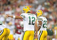 Aug. 28, 2009; Glendale, AZ, USA; Green Bay Packers quarterback (12) Aaron Rodgers calls an audible against the Arizona Cardinals during a preseason game at University of Phoenix Stadium. Mandatory Credit: Mark J. Rebilas-