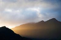 rays of sunlight shining through mountains