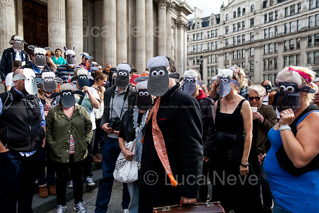 London, 26/09/2015. Today, comedian, journalist and political activist Mark Thomas staged a &quot;Shaun the Sheep&quot; demonstration in Paternoster Square, financial heart of the City of London and home of the London Stock Exchange. From the organiser Facebook page: &lt;&lt;Some of you may know I have been banned for life from walking in 6 London streets owned and controlled by the Oxford Properties Group, these streets are in Paternoster Sq. As we have had a right of way on these streets since Anglo Saxon times it seems a tad excessive, as my crime was walking dressed as a sheep. So I am organising a Mass Trespass of Shaun the Sheep! The aim is to get as many people as possible on to the Square wearing Shaun the Sheep masks and do a walk. [&hellip;]&gt;&gt;. <br /> From Wikipedia.org: &lt;&lt;Shaun the Sheep is a British stop-motion animated television series, a spin-off of the Wallace and Gromit franchise [&hellip;]&gt;&gt;.<br /> <br /> For more information please click here: http://on.fb.me/1KGvhff