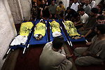 Palestinians mourn over the body of boys from the Baker family, whom medics said was killed with three other children from the same family by a shell fired by an Israeli naval gunboat, in Gaza city on July 16, 2014. Four Palestinian children were killed and one was critically wounded on a Gaza beach by the shell fired by the Israeli naval gunboat, a Palestinian health official said. Asked about the incident, an Israeli military spokesman in Tel Aviv said he was checking the report. Gaza health officials said 213 Palestinians, most of them civilians, had been killed in air and naval barrages, in the worst flareup of Israeli-Palestinian violence in two years. One Israeli has been killed by shelling from Gaza that has made a race to shelter a daily routine for hundreds of thousands in Israel. Photo by Ali Jadallah