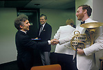 Vladimir Ashkenazy after rehearsals with Royal Philharmonic Orchestra at the Barbican being said hello to, by a member of the orchestra. 1990s London UK