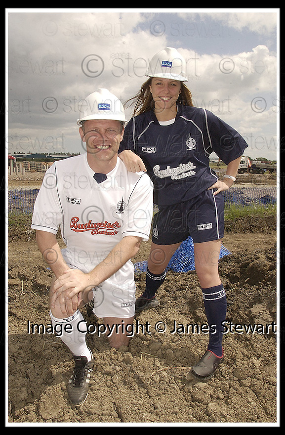 11/6/03           Copyright Pic : James Stewart              .File Name : stewart-ffc strip 03.FALKIRK PLAYER MANAGER JOHN YOGI HUGHES MODELS THE NEW FALKIRK AWAY STRIP WHILE KELLY ROY, WHO RUNS THE FALKIRK BABES CHEERLEADERS, MODELS THE NEW HOME STRIP AT THE SITE OF THE NEW STADIUM AT WESTFIELD..... .PAYMENTS SHOULD BE MADE TO :-.James Stewart Photo Agency, 19 Carronlea Drive, Falkirk. FK2 8DN      Vat Reg No. 607 6932 25.Office : +44 (0)1324 570906     .Mobile : + 44 (0)7721 416997.Fax     :  +44 (0)1324 570906.E-mail : jim@jspa.co.uk.If you require further information then contact Jim Stewart on any of the numbers above.........