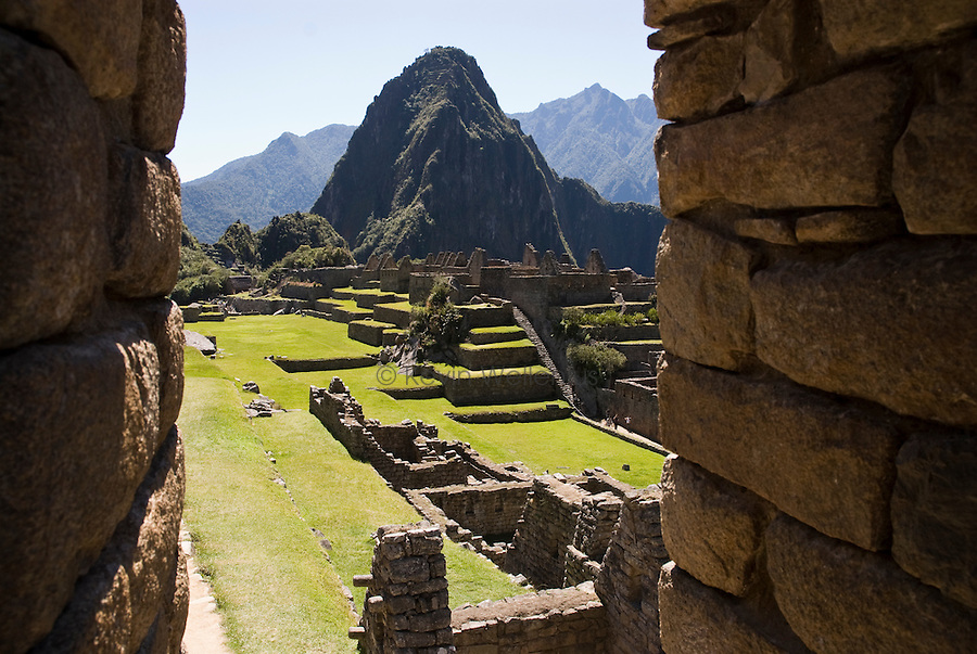 "The Inca ruins of the ""lost city"" of Machu Picchu, approximately 75 NW of Cusco, Peru, with Huayna Picchu peak (8922') in the background. Machu Picchu is Peru's most important tourist destination."
