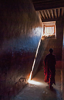 Pilgrims and buddhist Monks have to walk clockwise in the corridors at a Monastery, Tibet.