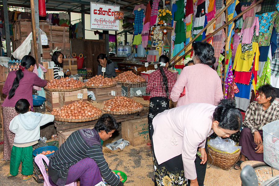 Myanmar, Burma.  Mandalay Market, Stall Selling Eggs and Clothing.