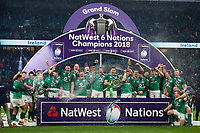 Ireland celebrate as Rory Best holds the 6 Nations trophy in celebration. Natwest 6 Nations match between England and Ireland on March 17, 2018 at Twickenham Stadium in London, England. Photo by: Patrick Khachfe / Onside Images