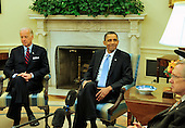 United States President Barack Obama smiles as he meets bipartisan leaders of the Senate and the bipartisan leaders of the Senate Judiciary Committee in the Oval Office to discuss the Supreme Court vacancy left by the retirement of Justice Stevens in Washington, D.C. on Wednesday, April 21, 2010.  Vice President Joseph Biden is at left and U.S. Senate Majority Leader Harry Reid (Democrat of Nevada) is at the right..Credit: Ron Sachs / Pool via CNP