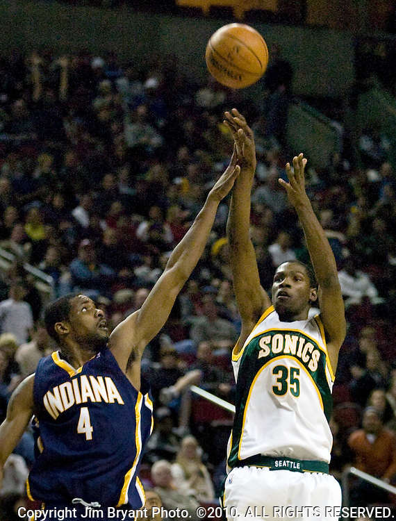 Seattle SuperSonics' Kevin Durant, right, hits a three-pointer over defending Indiana Pacers'  Shawne Williams in a NBA basketball game during the second half Friday, Nov. 30, 2007 in Seattle. Durant scored a career high 35 points in the SuperSonics 95-93 win over the Pacers. This was the first home court win for the Sonics this season.  Jim Bryant Photo. ©2010. All Rights Reserved.
