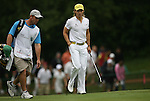 7 September 2008:    Camilo Villegas of Medellin, Colombia, South America with his caddy Gary Mathews on the ninth hole in the delayed third round of play at the BMW Golf Championship at Bellerive Country Club in Town & Country, Missouri, a suburb of St. Louis, Missouri on Sunday September 7, 2008. He and 23 other golfers had to finish their third round of competition Sunday morning before the fourth and final round could be played due to the suspension of third round play because of darkness on Saturday Sept. 6.  The BMW Championship is the third event of the PGA's  Fed Ex Cup Tour.