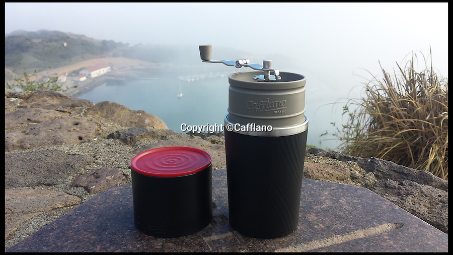 BNPS.co.uk (01202 558833)<br /> Pic: Cafflano/BNPS<br /> <br /> *Please use full byline*<br /> <br /> The Cafflano, ready to use anywhere.<br /> <br /> Coffee lovers can now make a brew on the go with freshly ground beans after the world's first coffee cup with its own grinder was launched.<br /> <br /> The Cafflano claims to be an all-in-one portable coffee maker allowing coffee fans to grind their own beans moments before using them to make a cup.<br /> <br /> The nifty new invention looks like a standard travel mug but hidden inside its clever design is a ceramic burr grinder and a drip filter.