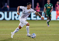 13th July 2020, Orlando, Florida, USA;  Los Angeles Galaxy forward Cristian Pavon (10) runs with the ball during the MLS Is Back Tournament between the LA Galaxy versus Portland Timbers on July 13, 2020 at the ESPN Wide World of Sports, Orlando FL.