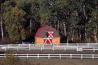 Log Barn and White Fence, Northern BC, British Columbia, Canada, Summer