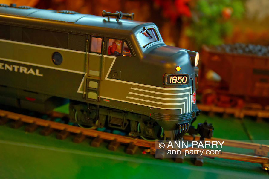 Dec. 26, 2012 - Garden City, New York, U.S. - The Long Island Garden Railway Society large-scale model train display is a festive winter holiday attraction in the vast 3-floor atrium of Cradle of Aviation museum, until shortly after New Years Day 2013. This is close-up of a G-scale New York Central engine speeding on tracks. LIGRS shares the knowledge, fun, and camaraderie of large-scale railroading both indoors and in the garden, and is family oriented.