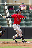 Brett Austin (10) of the Kannapolis Intimidators follows through on his swing against the Greensboro Grasshoppers at CMC-NorthEast Stadium on September 1, 2014 in Kannapolis, North Carolina.  The Grasshoppers defeated the Intimidators 7-4.  (Brian Westerholt/Four Seam Images)