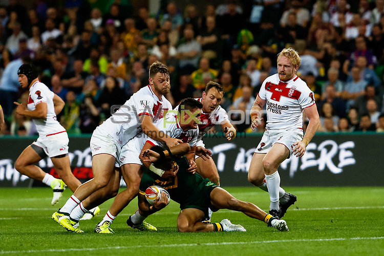 MANADTORY CREDIT Brendon Ratnayake/SWpix.com/Photosport.nz - 27/10/2017 - Rugby League World Cup - Australia vs England - AAMI Park, Melbourne, Australia - Australia's Valentine Holmes is tackled by England's Chris Heighington, Elliott Whitehead and James Roby.