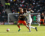 Harry Chapman of Sheffield Utd in action with Brandon Thomas-Asante of MK Dons during the English League One match at  Stadium MK, Milton Keynes. Picture date: April 22nd 2017. Pic credit should read: Simon Bellis/Sportimage