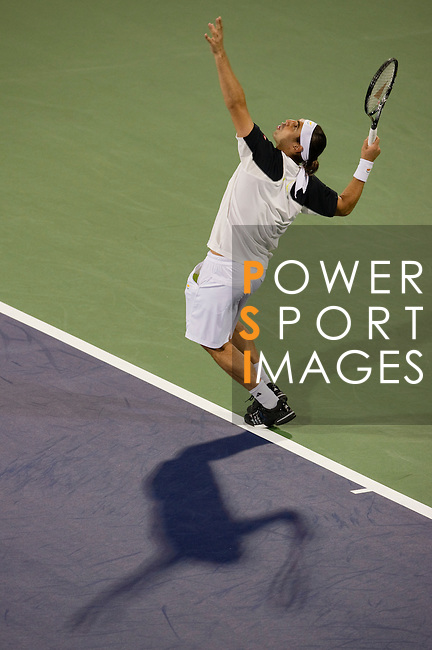 SHANGHAI, CHINA - OCTOBER 11:  Marcos Baghdatis of Cyrus serves to Jeremy Chardy of France during day one of the 2010 Shanghai Rolex Masters at the Shanghai Qi Zhong Tennis Center on October 11, 2010 in Shanghai, China.  (Photo by Victor Fraile/The Power of Sport Images) *** Local Caption *** Marcos Baghdatis