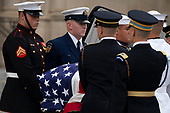 A Military Honor Guard carries casket of late Senator John McCain, Republican of Arizona, prior to a funeral for the late Senator at the Washington National Cathedral in Washington, DC on September 1, 2018. <br /> Credit: Alex Edelman / CNP