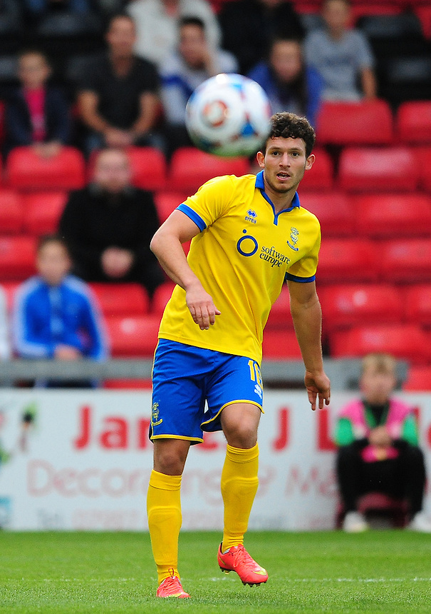 Lincoln City&rsquo;s Alex Simmons<br /> <br /> Photographer Chris Vaughan/CameraSport<br /> <br /> Football - Football Friendly - Lincoln City v Norwich City - Wednesday 29th July 2015 - Sincil Bank - Lincoln<br /> <br /> &copy; CameraSport - 43 Linden Ave. Countesthorpe. Leicester. England. LE8 5PG - Tel: +44 (0) 116 277 4147 - admin@camerasport.com - www.camerasport.com
