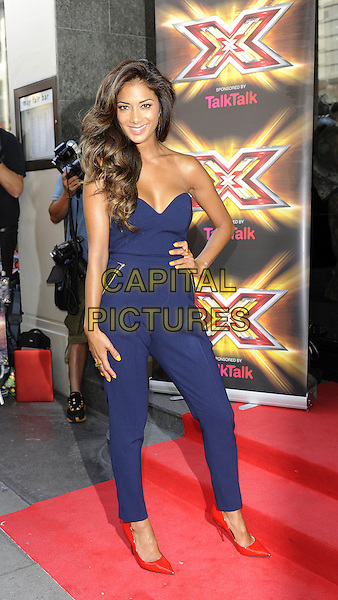 Nicole Scherzinger<br /> The X Factor press launch, Mayfair Hotel, London, England.<br /> August 29th, 2013<br /> full length blue strapless jumpsuit red shoes hand on hip <br /> CAP/DH<br /> &copy;David Hitchens/Capital Pictures