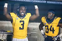 BERKELEY, CA - November 26, 2016: Cal's Cameron Walker (3) and De'Zhon Grace (34) on the sidelines. Cal played UCLA at California Memorial Stadium.