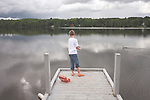 Nine year old boy fishing in Echo Lake at Aroostook State Park, Maine, USA