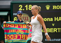 London, England, 2 July, 2016, Tennis, Wimbledon, Kiki Bertens (NED) ballboy brings a towel<br /> <br /> Photo: Henk Koster/tennisimages.com