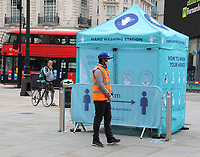 Hand Washing and Sanitising station at Piccadilly Circus<br /> Social Distancing, Hand Sanitiser stations and NHS signage around London as Lockdown restrictions are loosened by allowing Pubs, Restaurants and all retail to re-open. London on Saturday July 4th 2020<br /> <br /> Photo by Keith Mayhew