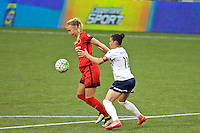 Portland, OR - Saturday, May 21, 2016: Portland Thorns FC midfielder Dagny Brynjarsdottir (11) is marked by Washington Spirit defender Ali Krieger (11). The Portland Thorns FC defeated the Washington Spirit 4-1 during a regular season National Women's Soccer League (NWSL) match at Providence Park.