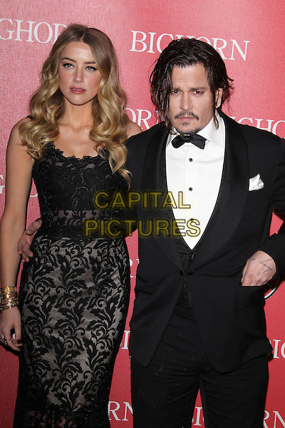 PALM SPRINGS, CA - JANUARY 2: Amber Heard and Johnny Depp at the 27th Annual Palm Springs International Film Festival Awards Gala at Palm Springs Convention Center on January 2, 2016 in Palm Springs, California. <br /> CAP/MPI24<br /> &copy;MPI24/Capital Pictures