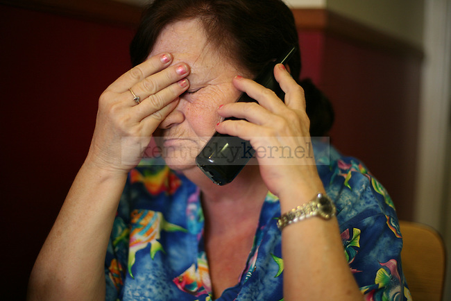 Owner Mary Lou Campbell answers a phone call for an order at The White Flash in Jackson, Ky., on Thursday, Oct. 13, 2011. The White Flash does deliveries, carry-out and dine-in. Photo by Tessa Lighty