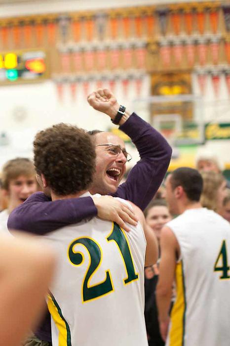 A parent celebrates after San Marin's upset victory against Bishop O'Dowd High School.